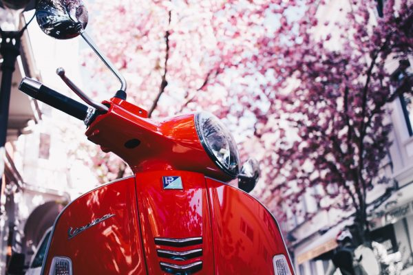 selective-focus-photography-of-red-motor-scooter-1528977